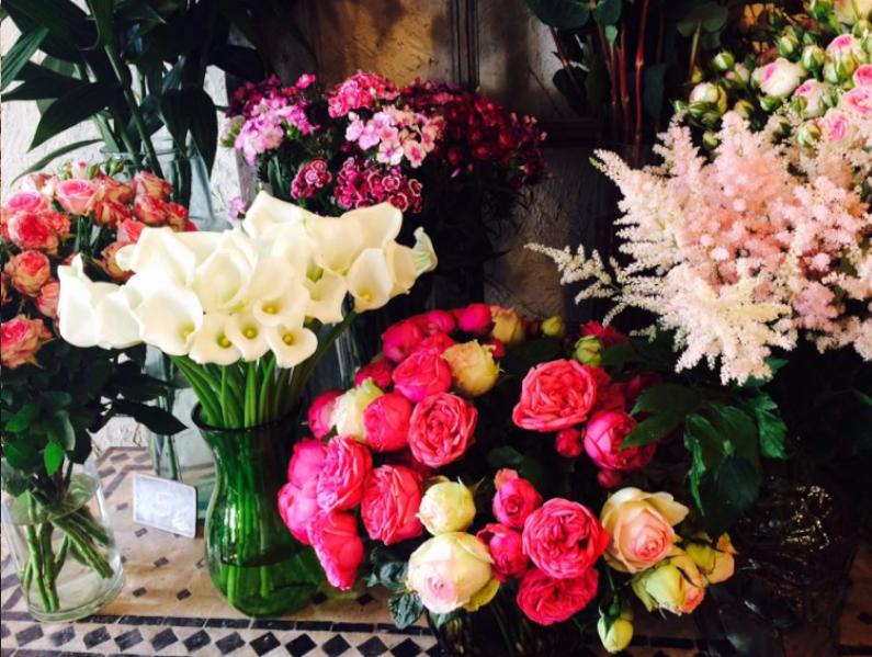 Bouquets de fleurs à l'arrosoir
